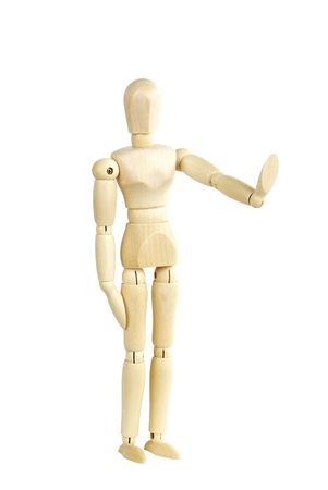 Wooden human at a stop pose Stock Photo - 5955384