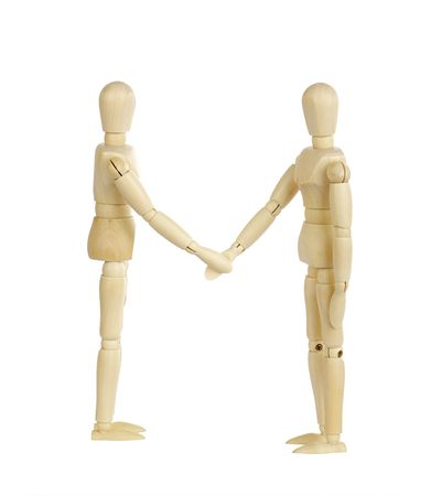 Two wooden figures shaking hands.