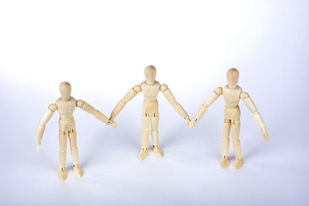 unification: Many Wood people join hands,Represents the unity of Stock Photo