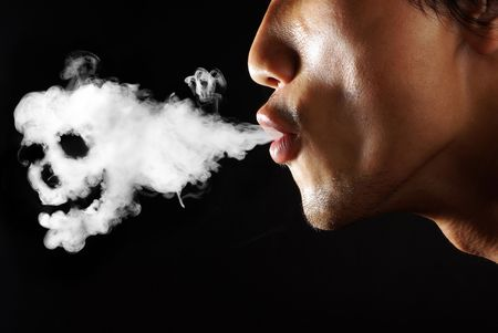 substance: Young man smoking cigarette over black background Stock Photo