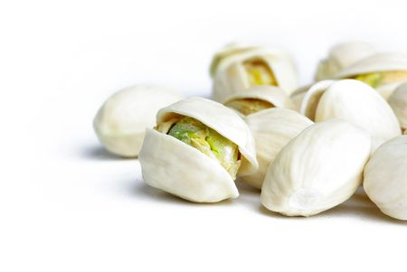 Detail of pistachios on white background Stock Photo - 6659870