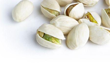 Detail of pistachios on white background Stock Photo - 6659610