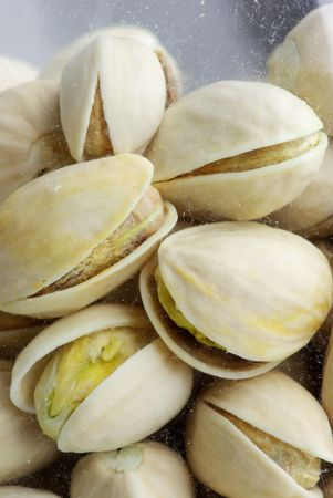 Features Background of salted pistachios