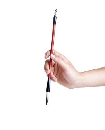 Hand holding Chines brush pen  Stock Photo