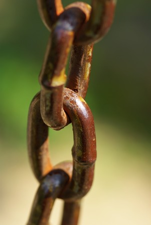 A rusty chain In the green background photo