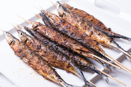 Grilled saury isolated on white background Stock Photo