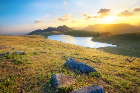 Majestic sunset in the mountains landscape. Stock Photo