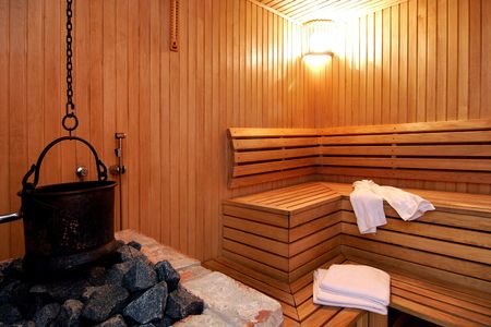 caldron: Sauna room with tovels and heating Stock Photo