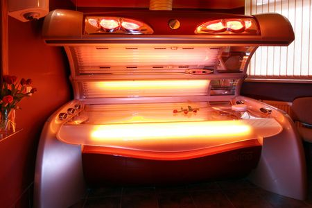 remedial: Red solarium bed with flower Stock Photo