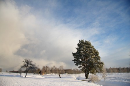 Impressive winter landscape with dark clouds over sky photo