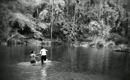 childen: Childen playing stream waterfall Stock Photo