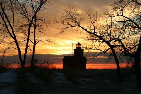 sihlouette: A sihlouette of Big Red lighthouse near Holland, Michigan Stock Photo