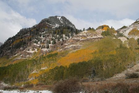 Maroon Bells with aspen trees in the foreground photo