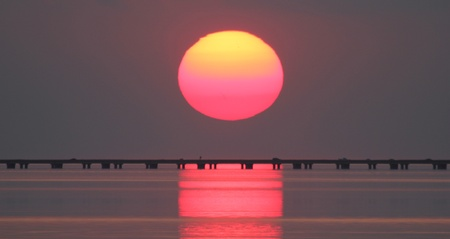 going down: The sun going down over Lake Pontchartrain Stock Photo