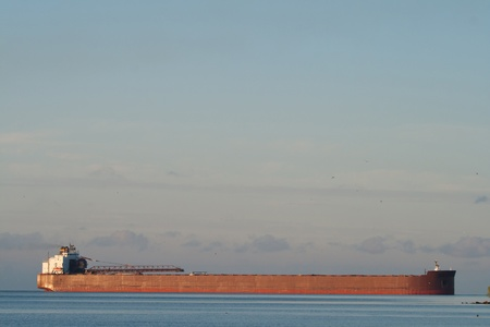 A great lakes freighter approaching a port (lots of copy space)