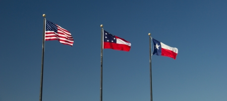 A trio of flags that fly or have flown over Texas Stock Photo
