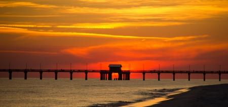 A view of a Gulf Coast fishing pier at sundown