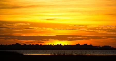 The sun setting over Galveston Island