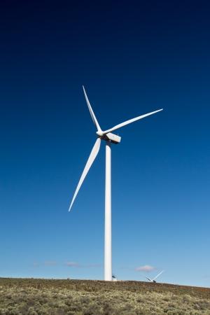 Windmill at a wind generation farm Stock Photo