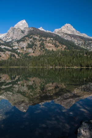 Teton peaks reflected in an alpine lake