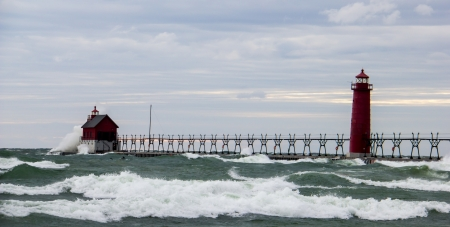 Lighthouse near Grand Haven, MI being pounded by high waves photo
