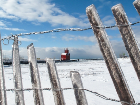 Historic Big Red lighthouse in a winter setting