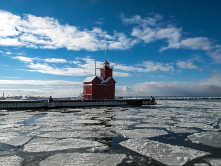 Historic Big Red lighthouse in a winter setting photo
