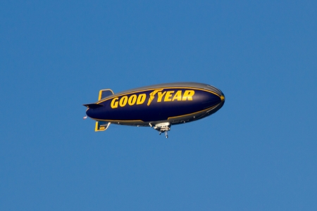 Pasadena, CA, USA - January 1, 2011 - The Goodyear blimp flying over the Tournament of Roses Parade Editorial