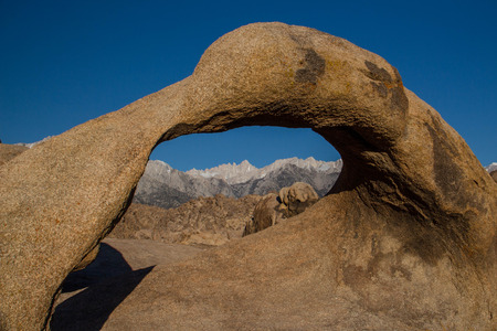 A view of Mt. Whitney through Mobius Arch in the Alabama Hills