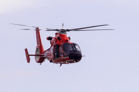 Galveston Island, Texas, USA - January 6, 2012;  A Coast guard helicopter patroling off Galveston Island Stock Photo - 66048192