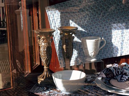 collectable: Antique Candel Holders and Tea Cups on Display