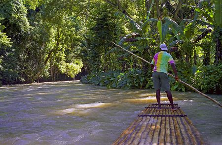 Man on a river raft in Jamaica