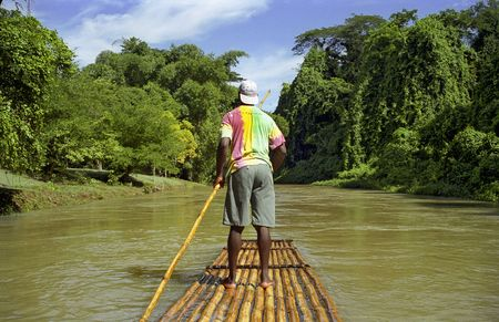 A Raft Captain from Ochos Rios on a calm river