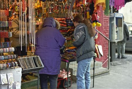merchant: Grandmother and Granddaughter shopping at a booth in New York Cits Chinatown Section  Stock Photo