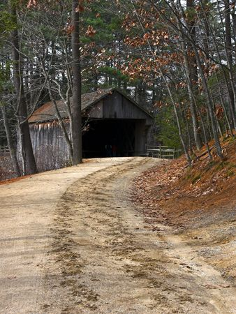 covered bridge': A very old dirt road leading to a Covered Bridge
