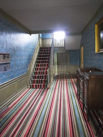 A very old Striped Carpet in a Colonial Home photo