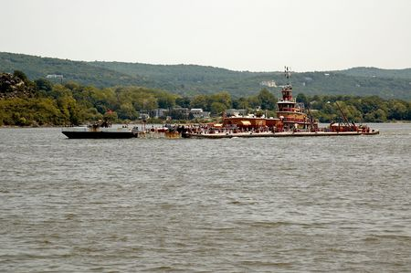tug boat: A Tug Boat and a barge on the Hudson River Stock Photo
