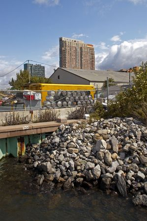 kegs: Rockpile and kegs at Queens Dock Site Stock Photo