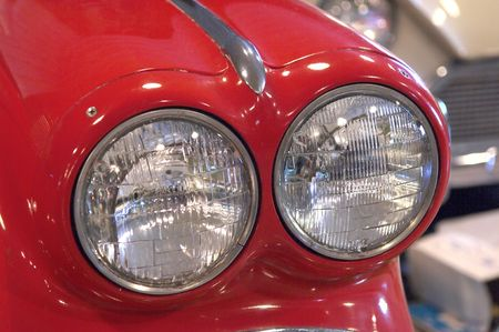 dual: Dual Head Lights on a Red Sports Car
