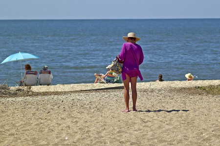 single woman: Single Woman at Sunset Beach,Cape May,  New Jersey on Labor Day Weekend 2010 Stock Photo