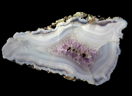 chiefly: polished agate slice on a black background