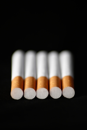 Cigarettes on black background photo