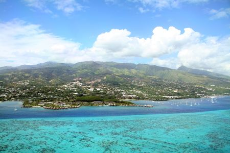 ressort on coral reef and lagoon, Tahiti Island Stock Photo
