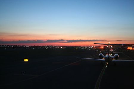 busy airport taxiway at dawn, new York JFK