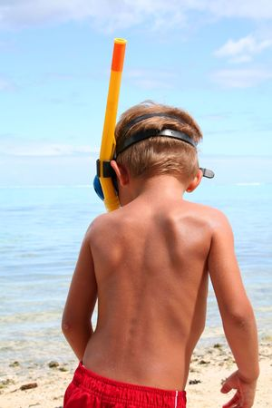 tuba: Boy on the beach with mask and tuba Stock Photo