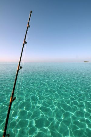 fishing rod over a turquoise lagoon