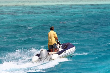 man on an inflatable yacht tender photo