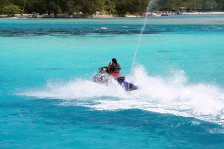 woman on a jetski on a turquoise lagoon