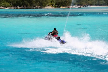 woman on a jetski on a turquoise lagoon
