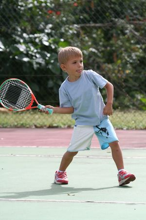 young tennis player ready to hit the ball photo